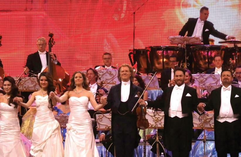 CONDUCTOR-VIOLINIST Andre Rieu (center) flanked by guest sopranos and tenors, with his orchestra at back. (photo credit: SIVAN FARAG)