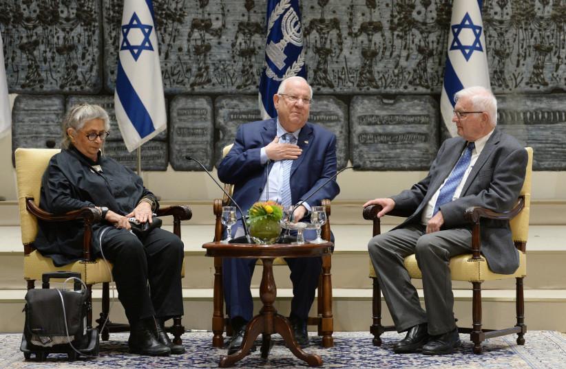 President Reuven Rivlin (C) and Nechama Rivilin (L) host a Zikaron BaSalon event on April 10, 2018. (photo credit: Mark Neiman/GPO)