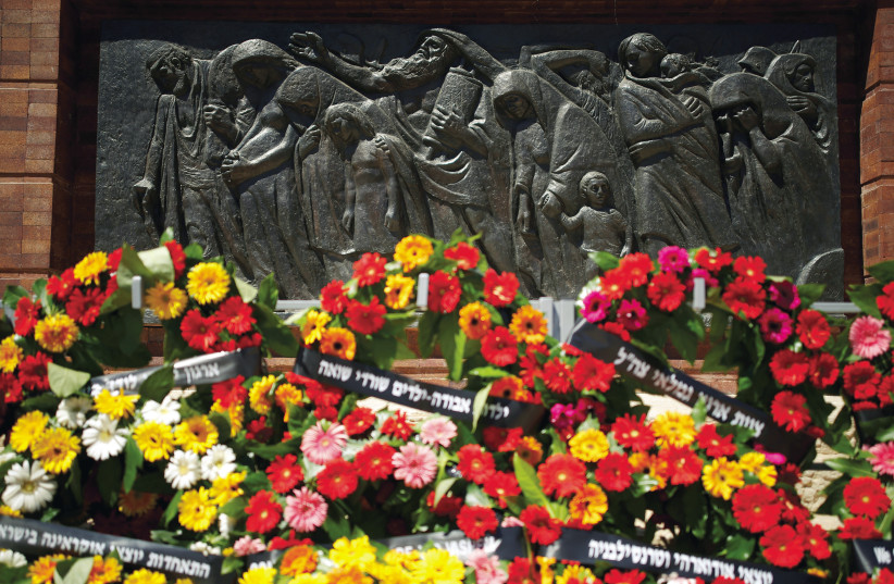 WREATHS ARE seen next to a sculpture during a ceremony marking Holocaust Remembrance Day at Warsaw Ghetto Square at Yad Vashem (photo credit: REUTERS)