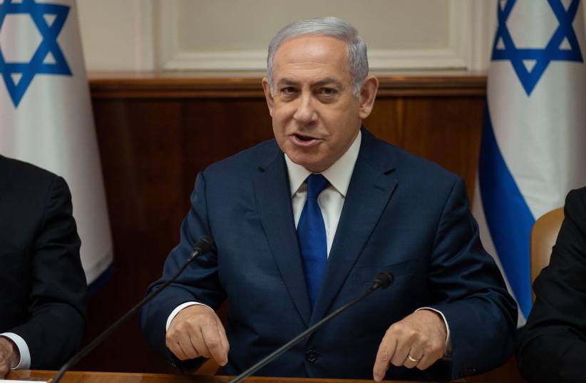 Prime Minister Benjamin Netanyahu at a cabinet meeting (photo credit: YOAV DAVIDKOVITZ / POOL)
