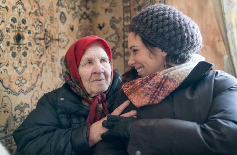 IFCJ Global Vice President Yael Eckstein with a Holocaust survivor (photo credit: IFCJ)
