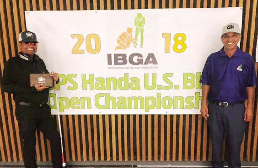 Israeli golfer Zohar Sharon (left) added yet another title to his long resume when he won the ISPS Handa 2018 US Blind Golf Open at the Haven Golf Course in Green Valley Arizona at the start of the week with the help of caddie Shimshon Levi (right) (photo credit: Courtesy)