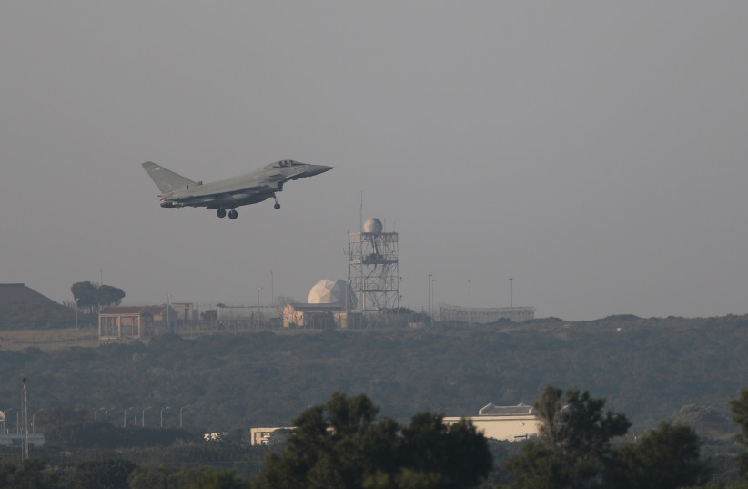 A British fighter jet takes off from an RAF base in Cyrpus to strike Syria  (photo credit: YIANNIS KOURTOGLOU/REUTERS)