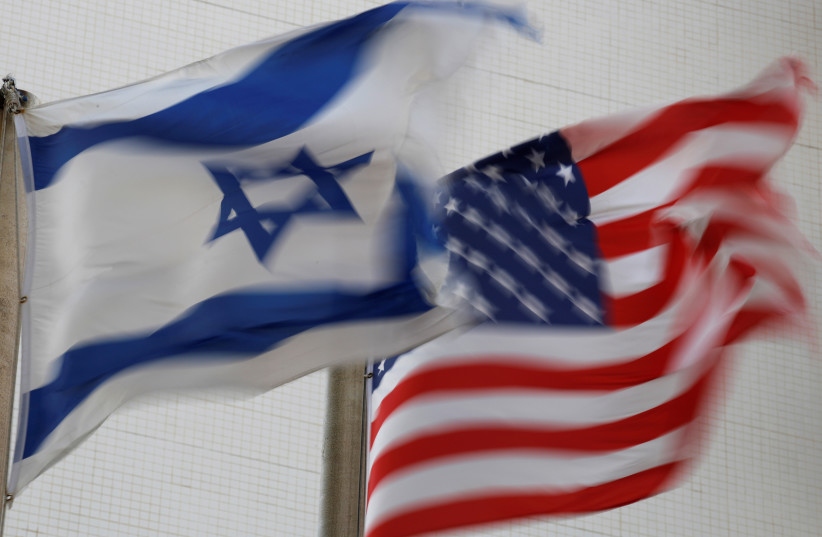 The American and the Israeli national flags can be seen outside the U.S Embassy in Tel Aviv, Israel December 5, 2017 (photo credit: AMIR COHEN - REUTERS)