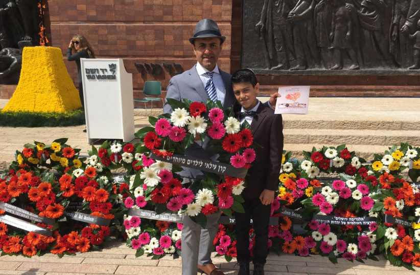 Albert Shaltiel and his son Ilai at the Holocaust Day wreath laying (photo credit: JULIJA LEVIN)