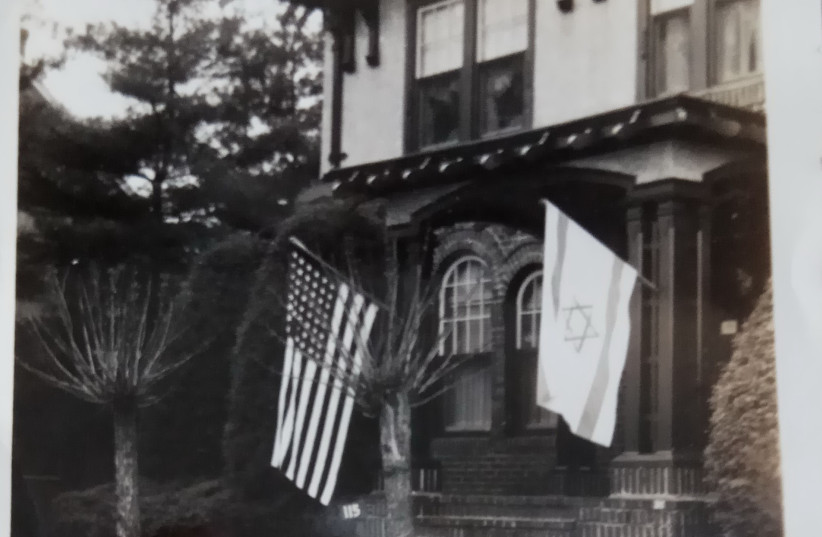 Thelma Jacobsn's childhood home, with Israeli and American flags flying out front (photo credit: Courtesy)