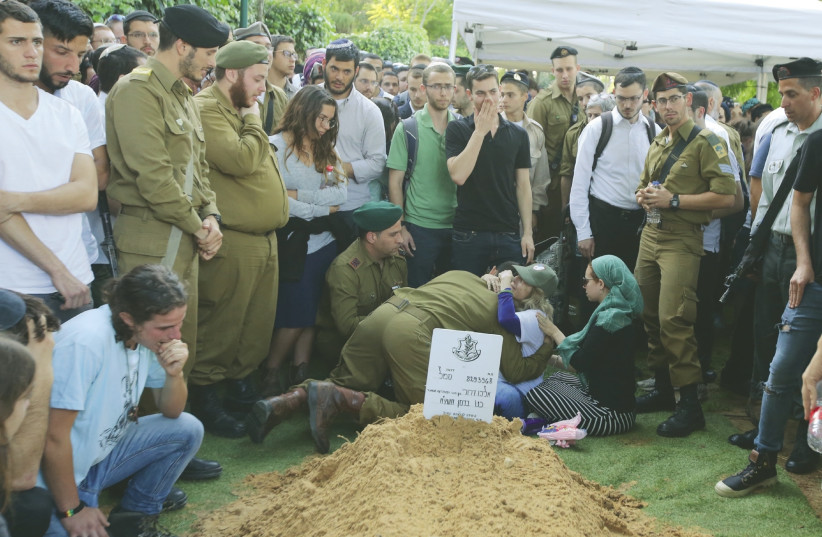 SGT. ELIYAHU DRORI, 22, an American-born soldier from Beit Shemesh, is buried at the Mount Herzl Military Cemetery in Jerusalem on Sunday (photo credit: MARC ISRAEL SELLEM/THE JERUSALEM POST)