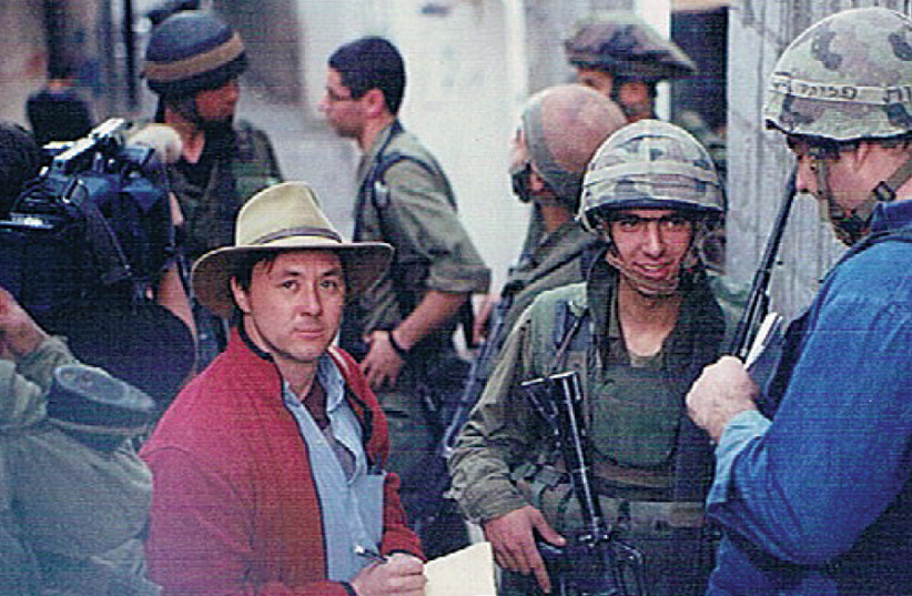 ARIEH O'SULLIVAN speaks to paratroopers in the Balata refugee camp in Nablus during the Second Intifada (photo credit: Courtesy)