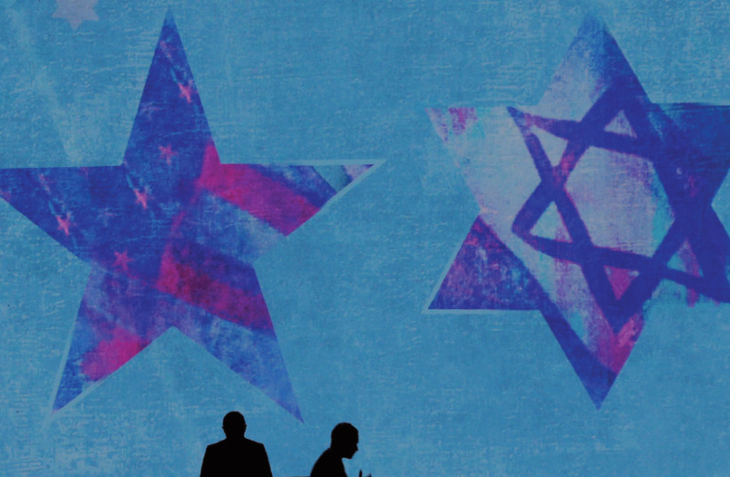 The backdrop of the stage at last year's AIPAC conference in Washington, DC (photo credit: REUTERS)