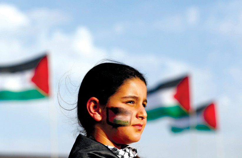 AN ISRAELI Arab girl takes part in a 'Land Day' rally, an annual commemoration of the killing of six Arab citizens by Israeli police in 1976 during protests against land confiscations in Deir Hanna in Galilee (photo credit: REUTERS)