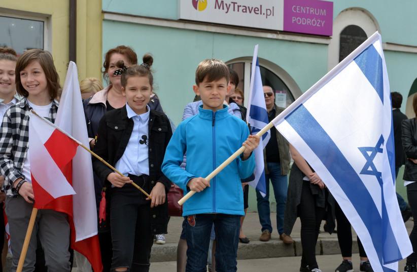 Polish children holding Israeli and Polish flags in Plonsk, the birthtown of David Ben-Gurion  (photo credit: YOSSI ZELINGER)