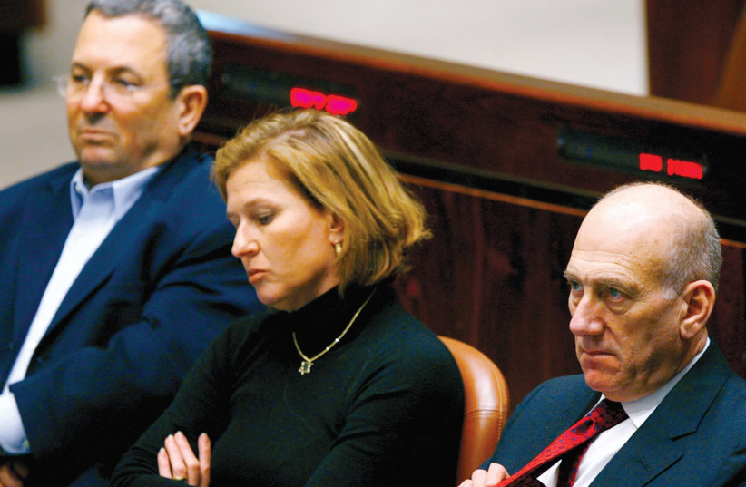 THEN-PRIME MINISTER Ehud Olmert (right), foreign minister Tzipi Livni and defense minister Ehud Barak attend a special session in the Knesset marking Holocaust Remembrance Day in 2008. (photo credit: REUTERS)