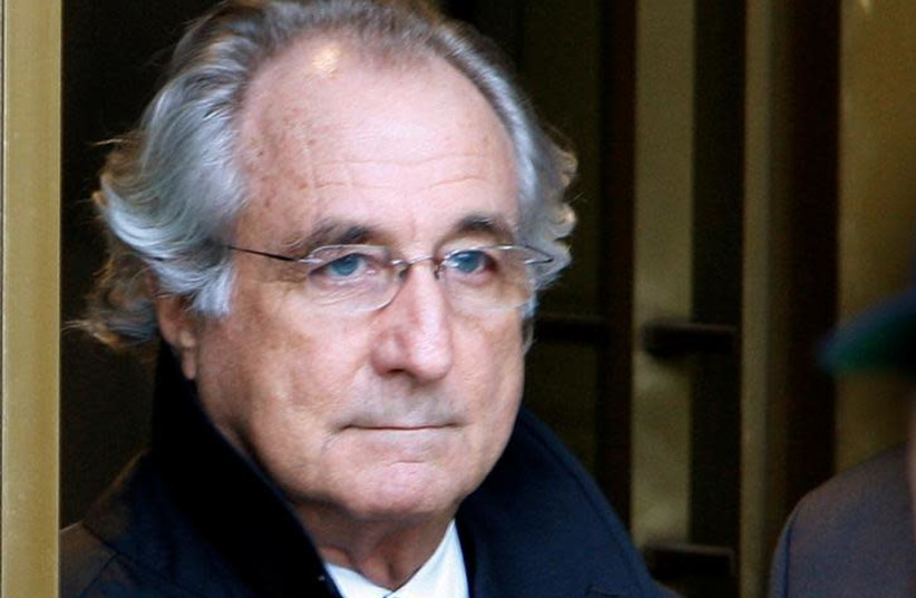 Accused swindler Bernard Madoff exits the Manhattan federal court house in New York, U.S. on January 14, 2009 (photo credit: BRENDAN SMIALOWSKI / AFP)