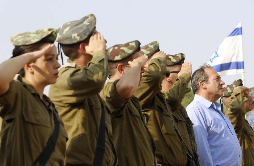 President and Founder of the International Fellowship of Christians and Jews, Rabbi Yechiel Eckstein, is seen with IDF soliders; the Fellowship is heavily invested in supporting its lone soldiers (photo credit: COURTESY IFCJ)