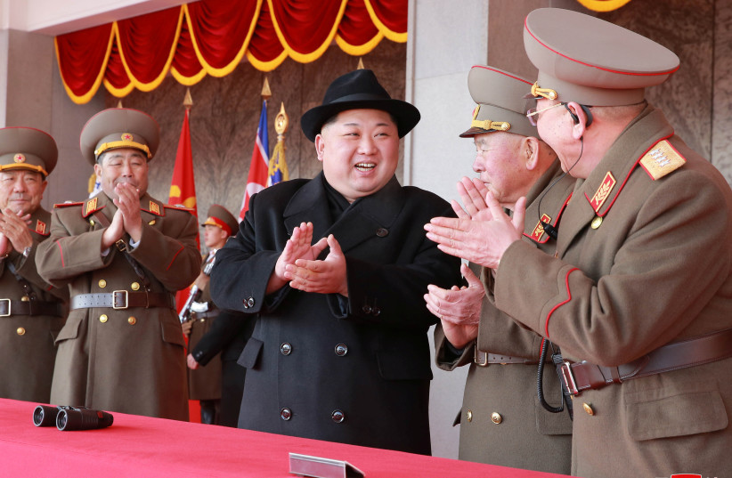Kim Jong Un attends a grand military parade celebrating the 70th founding anniversary of the Korean People's Army in Pyongyang, in this photo released by North Korea's Korean Central News Agency (KCNA) February 9 2018 (photo credit: KCNA/ REUTERS)