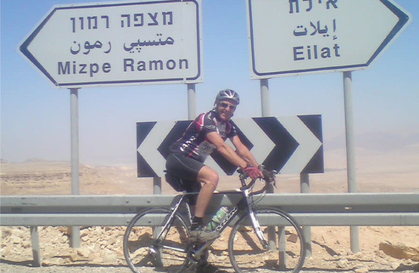 The writer, Barry Davis, on Eagle Hill, just before the long descent to the Arava highway, around 55 km. before Eilat (photo credit: BARRY DAVIS)