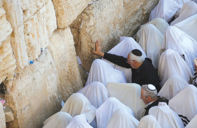 WORSHIPERS gather at the Western Wall for the blessing of the kohanim. (photo credit: REUTERS)