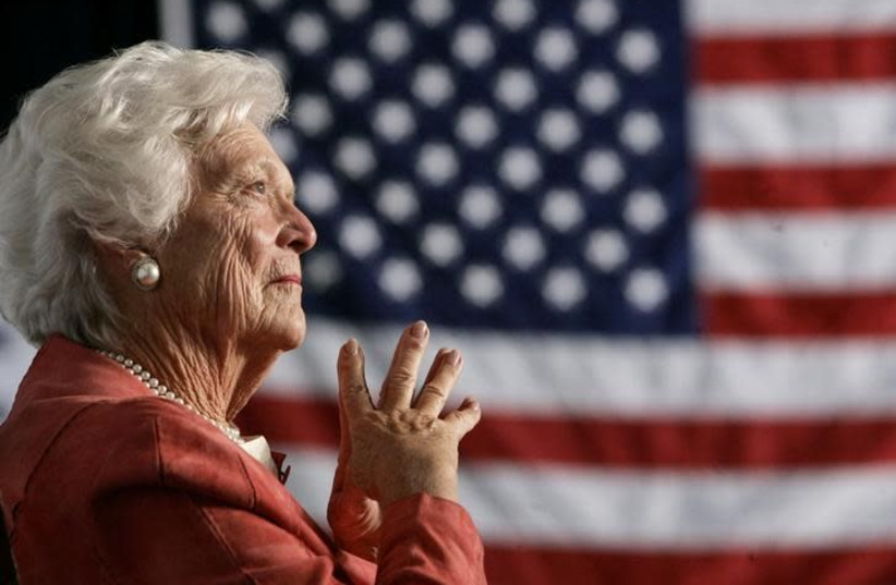 Former US first lady Barbara Bush listens to her son, President George W. Bush, as he speaks at an event on social security reform in Orlando, Florida March 18, 2005 (photo credit: REUTERS/JASON REED)