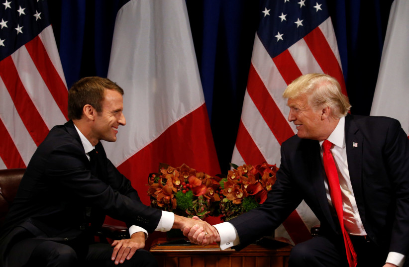 US President Donald Trump meets French President Emmanuel Macron in New York, US, September 18, 2017. (photo credit: REUTERS/KEVIN LAMARQUE)