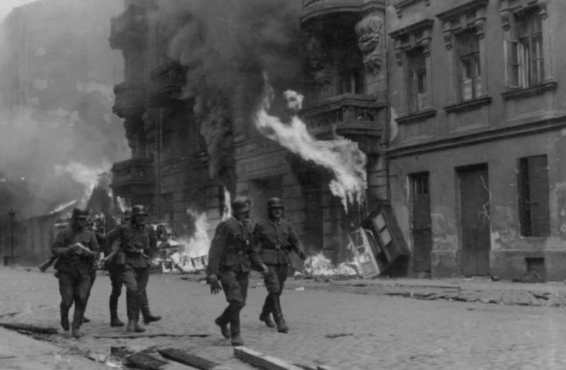 SS SOLDIERS patrol Nowolipie Street in the Warsaw Ghetto during the 1943 uprising (photo credit: Wikimedia Commons)