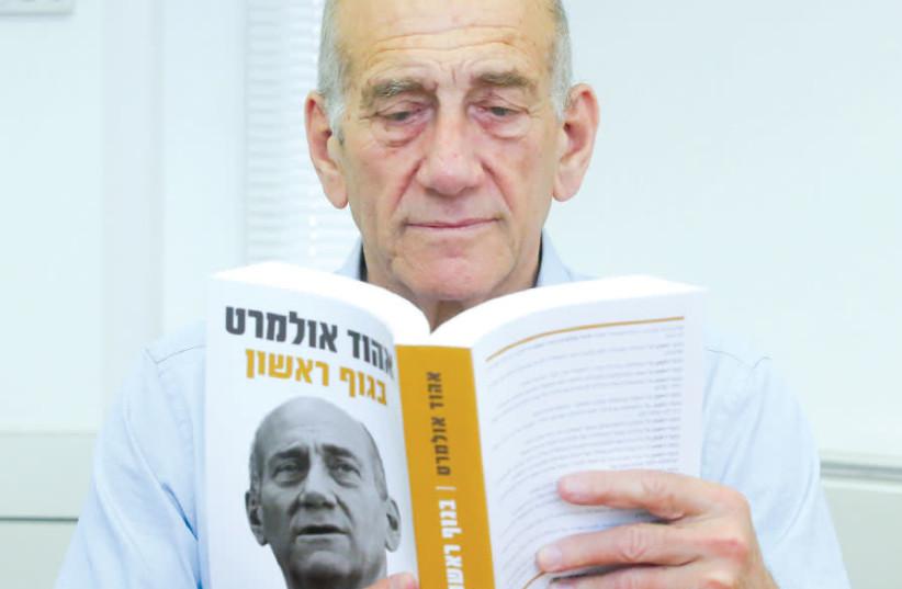FORMER prime minister Ehud Olmert reads his new book (photo credit: MARC ISRAEL SELLEM)