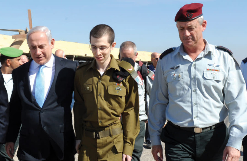 Captured IDF soldier Gilad Schalit (center), seen here shortly after his release from Gaza in October 2011aptured IDF soldier Gilad Schalit (center), seen here shortly after his release from Gaza in October 2011 (photo credit: AVI OHAYON - GPO)