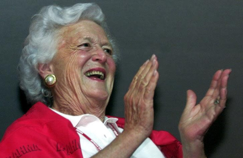 Barbara Bush, the mother of US President George W. Bush, watches the Carnival parade from a VIP room at the Sambadrome stadium, in Rio de Janeiro, Brazil, February 10, 2002 (photo credit: JAMIL BITTAR/REUTERS)