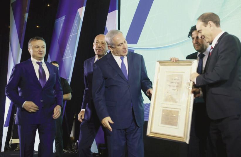 PRIME MINISTER Benjamin Netanyahu receives the Keren Hayesod Isaiah Award from Eliezer (Modi) Sandberg and David Koschitzky. (photo credit: AVI OHAYON - GPO)