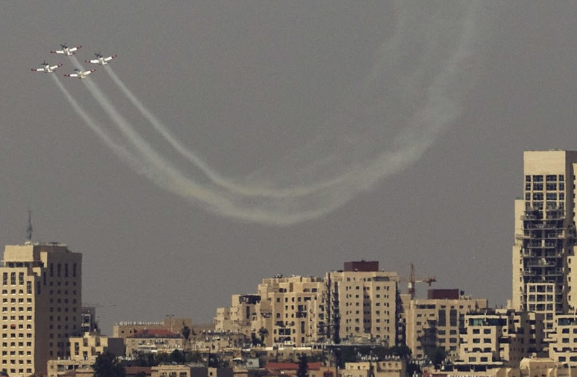 AN ISRAEL AIR FORCE aerobatic team flies in formation during an aerial show for Independence Day over Jerusalem on April 19th, 2018. (photo credit: REUTERS)