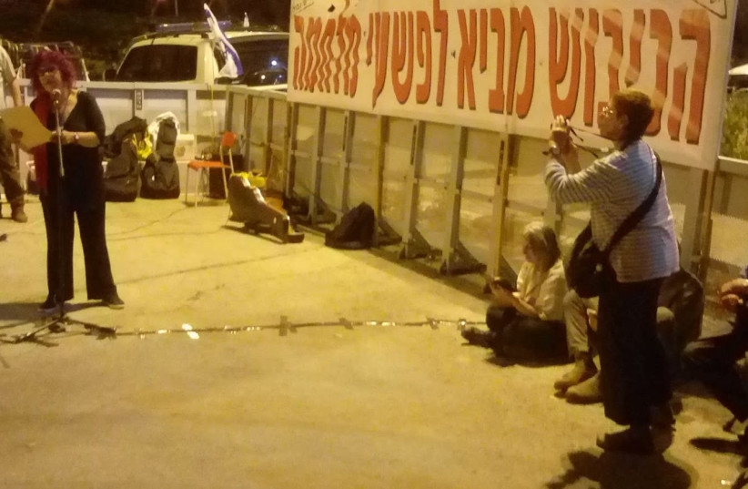 'REFUSE THE OCCUPATION,' the Yesh Gvul NGO's banners read across from the Prime Minister's Office in Jerusalem on April 19th, 2018.. (photo credit: ERAN TORBINER)