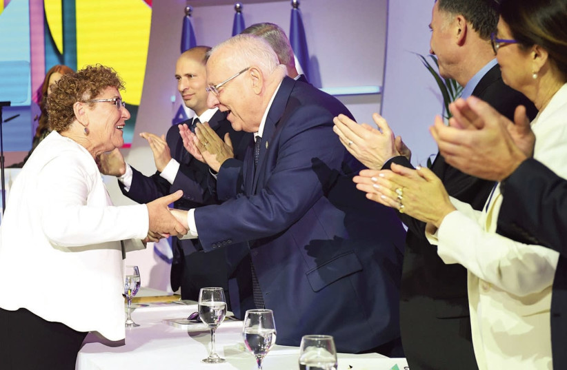 Miriam Peretz (L) shakes hands with Israel President Reuven Rivlin (R) during the Israel Prize ceremony in Jerusalem on Independence Day, April 19th, 2018. (photo credit: GPO)