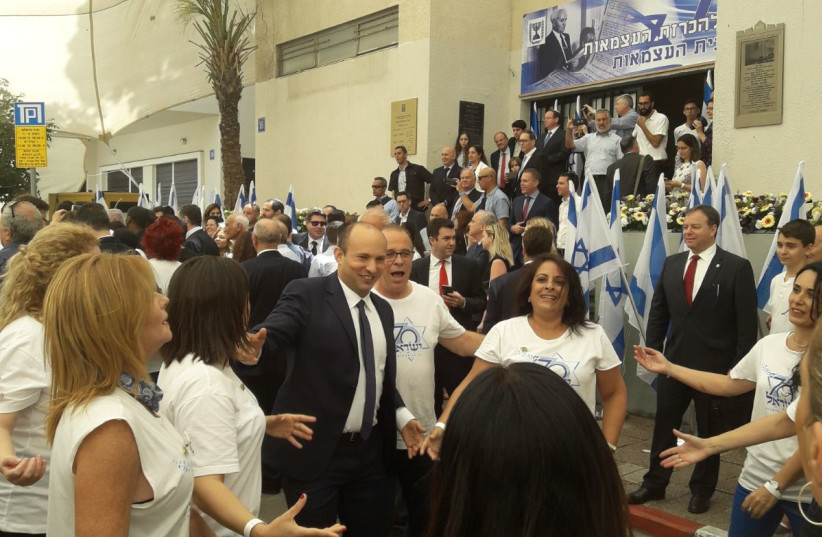 Education Minister Naftali Bennett joins the crowd in dancing the Hora during festivities in honor of Israel's 70th Independence Day at Independence Hall in Tel Aviv, April 2018 (photo credit: YANIR COZIN / MAARIV)
