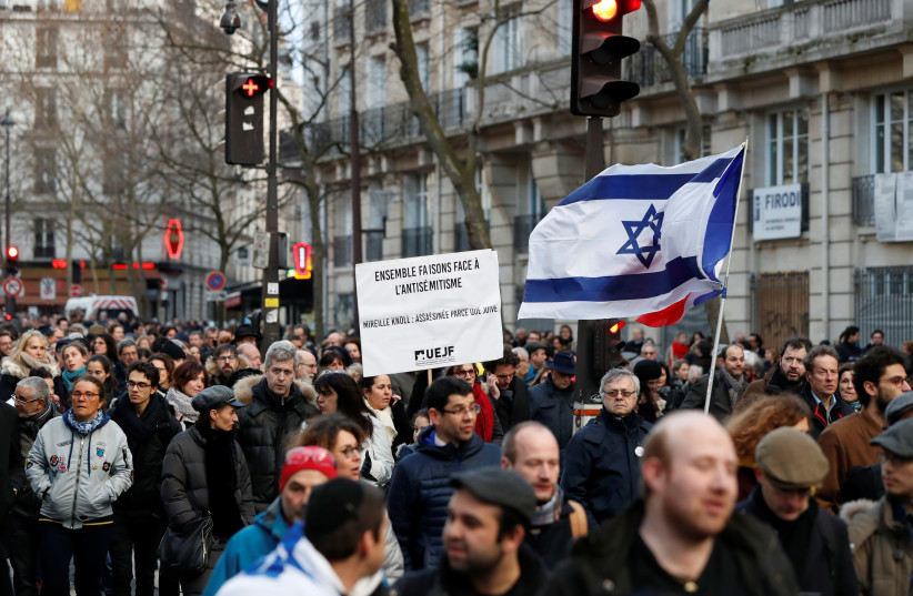 People participate in a unity rally after the murder of French Holocaust survivor Mireille Knoll in Paris (photo credit: GONZALO FUENTES / REUTERS)