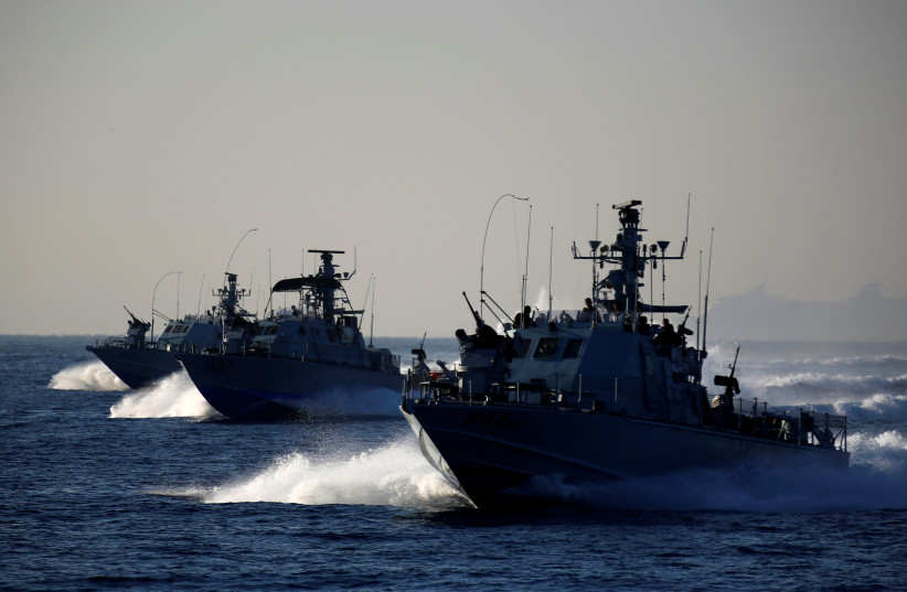 Israeli navy patrol vessels take part in a drill simulating the targeting of an infiltrated enemy vessel and the evacuation of a patrol boat, in the Mediterranean Sea off the coast of Ashdod, southern Israel November 8, 2016. (photo credit: AMIR COHEN/REUTERS)