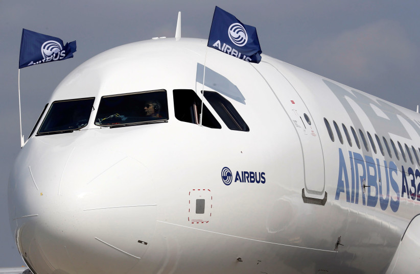 Flight test engineers drive the Airbus A320neo (New Engine Option) after its first flight in Colomiers near Toulouse, southwestern France, September 25, 2014. (photo credit: REUTERS/REGIS DUVIGNAU)