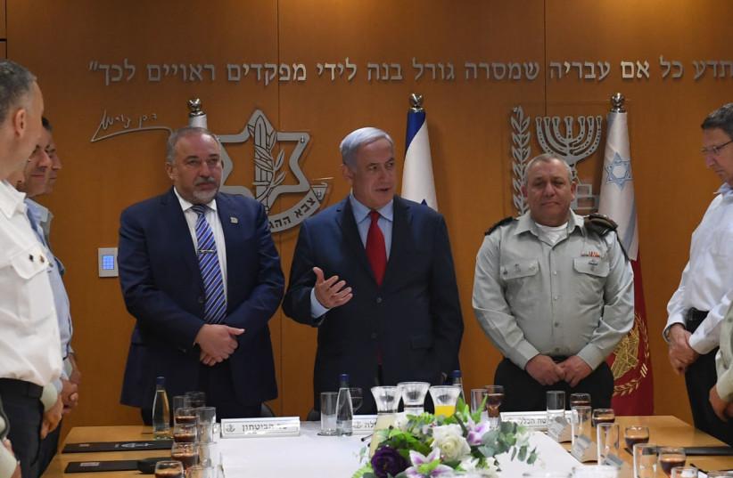 Prime Minister Benjamin Netanyahu, Defense Minister Avigdor Liberman, IDF Chief of Staff Gadi Eisenkot at a toast to Israel's 70th anniversary on April 22, 2018. (photo credit: KOBI GIDON / GPO)