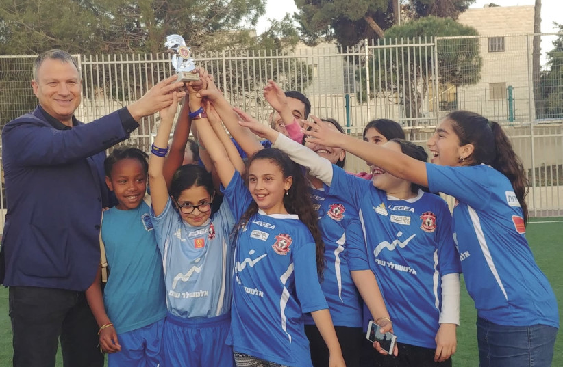 EREL MARGALIT celebrates with young soccer players in Jerusalem (photo credit: Courtesy)