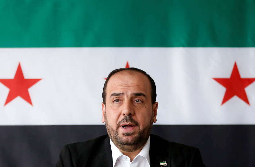 Nasr al-Hariri, Head of the Syrian Negotiation Commission, speaks at a news conference in Brussels (photo credit: FRANCOIS LENOIR / REUTERS)