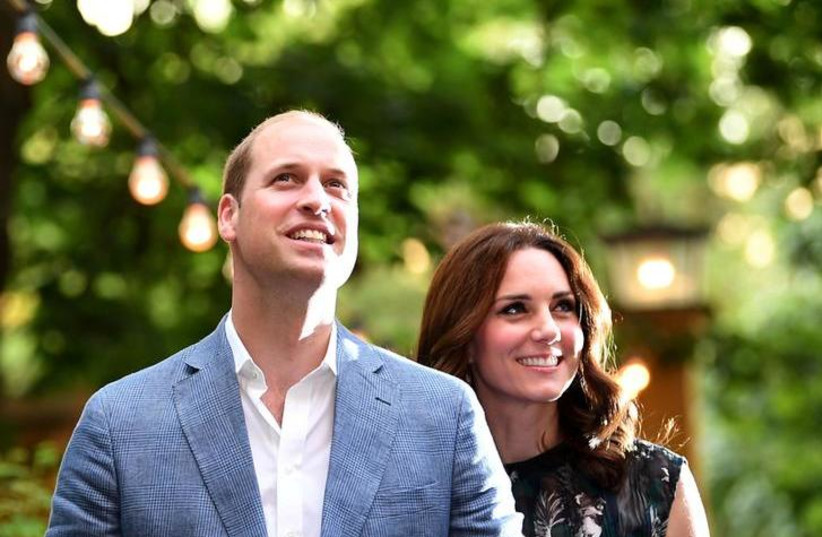 Britain's Prince William, the Duke of Cambridge and his wife Princess Kate, the Duchess of Cambridge, attend a reception at Claerchens Ballhaus, in Berlin Germany, July 20, 2017 (photo credit: REUTERS/BRITTA PEDERSEN)