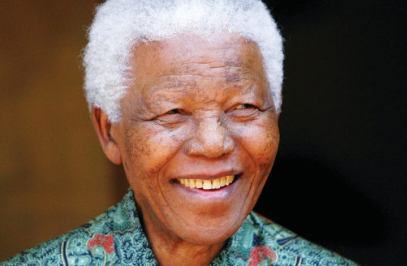 Nelson Mandela outside his home in 2005 (photo credit: REUTERS/MIKE HUTCHINGS)