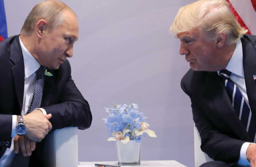 Russia's President Vladimir Putin faces off with US President Donald Trump at the G20 summit in Hamburg on July 7, 2017 (photo credit: CARLOS BARRIA / REUTERS)