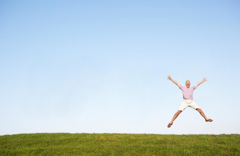 Happy man jumping in air (photo credit: INGIMAGE)