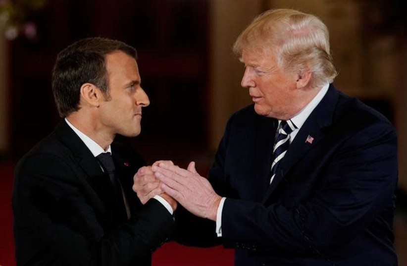 French President Emmanuel Macron shakes hands with U.S. President Donald Trump at the conclusion of their joint news conference in the East Room of the White House in Washington, U.S., April 24, 2018 (photo credit: REUTERS/JONATHAN ERNST)