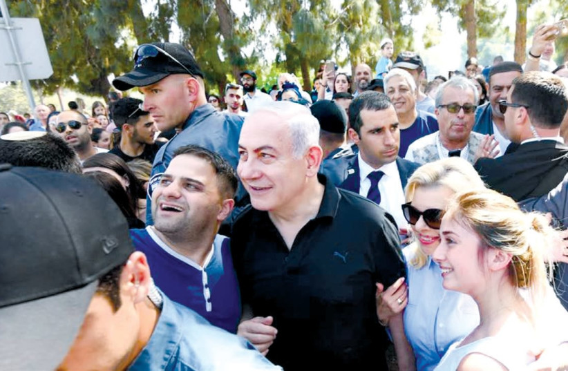 PRIME MINISTER Benjamin Netanyahu and his wife, Sara, join the public in the Wohl Rose Garden, opposite the Knesset, on Independence Day (photo credit: GPO)