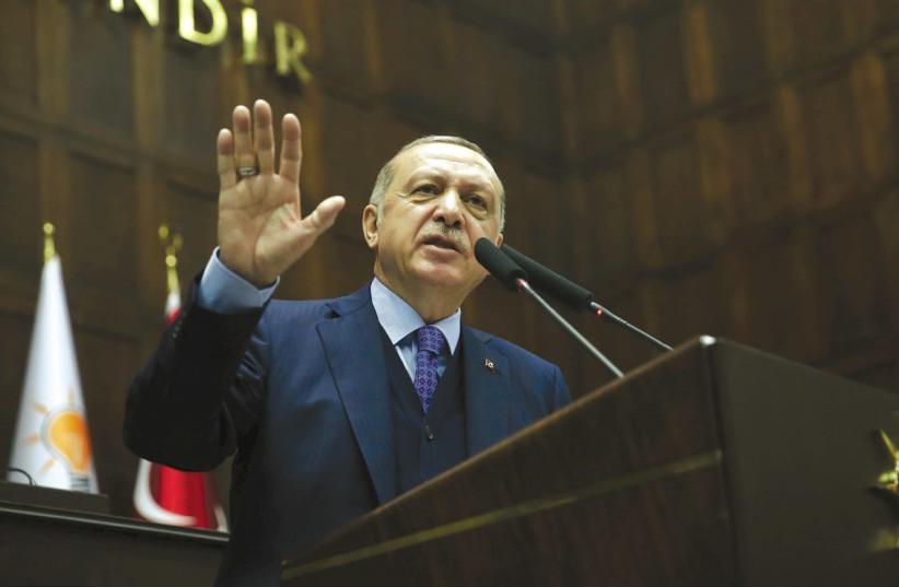 TURKISH PRESIDENT Tayyip Erdogan addresses members of the parliament from his AK Party in Ankara on April 24th, 2018.. (photo credit: MURAT CETINMUHURDAR/PRESIDENTIAL PALACE/REUTERS)