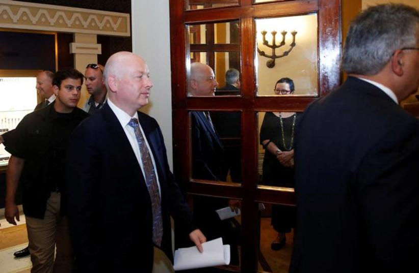Jason Greenblatt (C), U.S. President Donald Trump's Middle East envoy, enters a meeting in Jerusalem July 13, 2017.  (photo credit: RONEN ZVULUN/REUTERS)