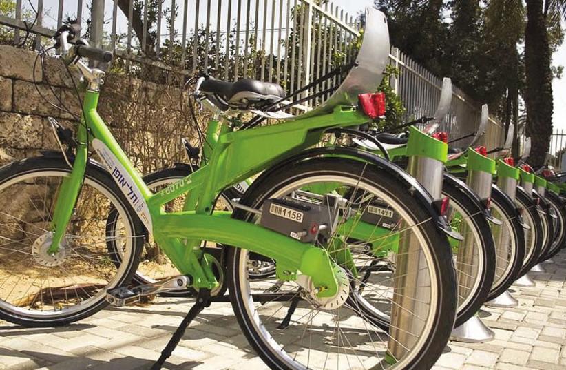 A bicycle rack as part of Tel Aviv's Tel-O-Fun bike-sharing program. (photo credit: Wikimedia Commons)