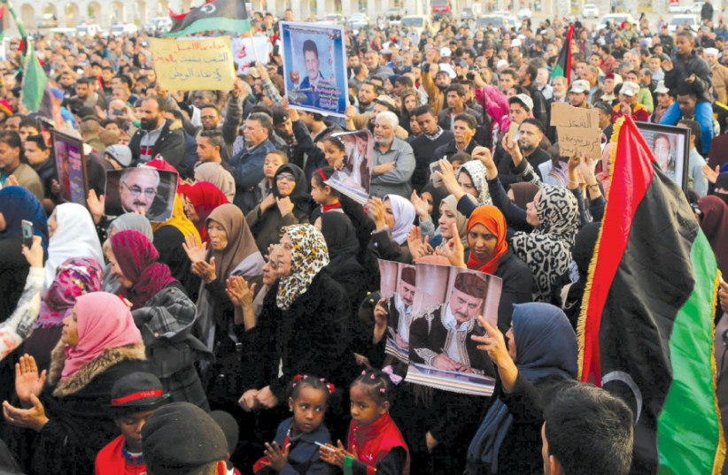 SUPPORTERS OF Eastern Libyan military commander Khalifa Haftar take part in a rally in Benghazi, Libya, calling for Haftar to take over after a UN deal for a political solution missed what they said was a self-imposed deadline in December 2017 (photo credit: REUTERS/ESAM OMRAN AL-FETORI)