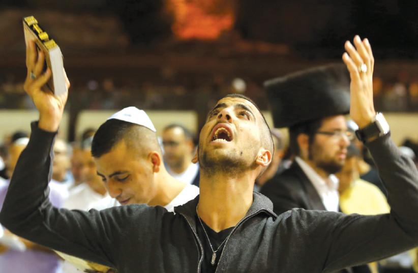 A WORSHIPER prays at the Western Wall (photo credit: MARC ISRAEL SELLEM)