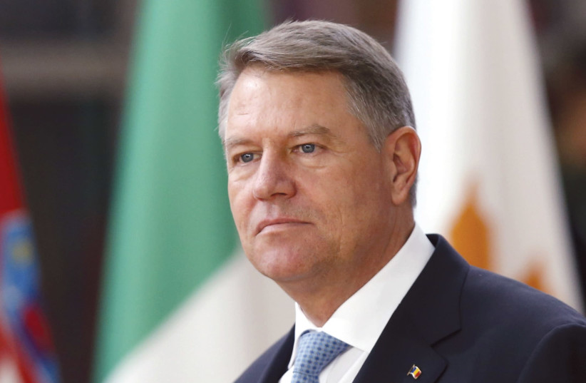 Iohannis arrives at a European Union leaders summit in Brussels (photo credit: REUTERS)